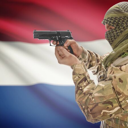 insurgency: Man with gun in hand and national flag on background series - Netherlands