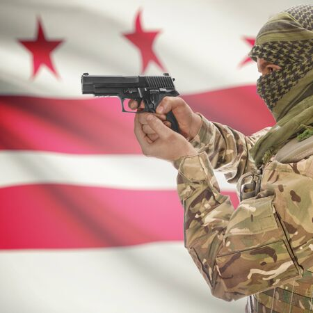 extremist: Male with gun in hand and American state flag on background series - District of Columbia Stock Photo