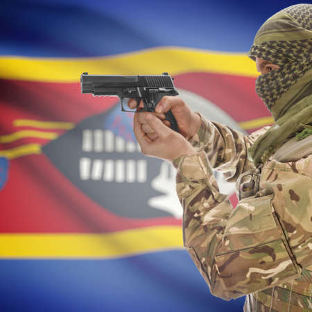 counterterrorism: Man with gun in hand and national flag on background series - Swaziland Stock Photo