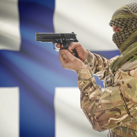 national police agency: Man with gun in hand and national flag on background series - Finland