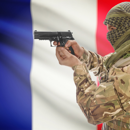 counterterrorism: Man with gun in hand and national flag on background series - France