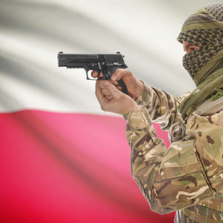 counterterrorism: Man with gun in hand and national flag on background series - Poland Stock Photo