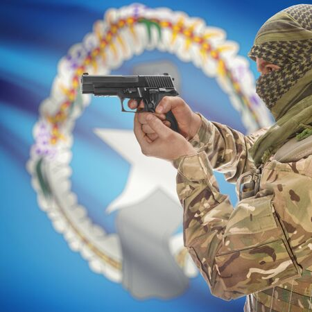 mariana: Man with gun in hand and national flag on background series - Northern Mariana Islands