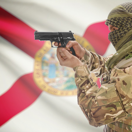 floridian: Male with gun in hand and American state flag on background series - Florida Stock Photo