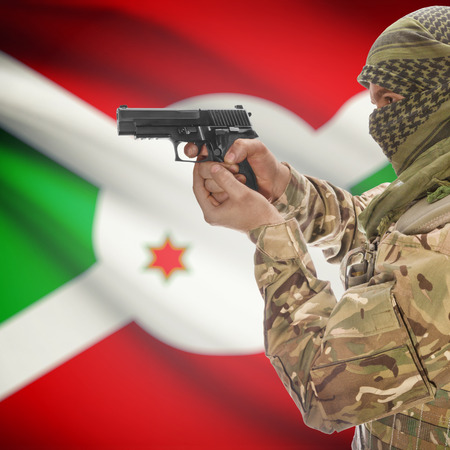 insurgency: Man with gun in hand and national flag on background series - Burundi