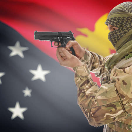 insurgency: Man with gun in hand and national flag on background series - Papua New Guinea