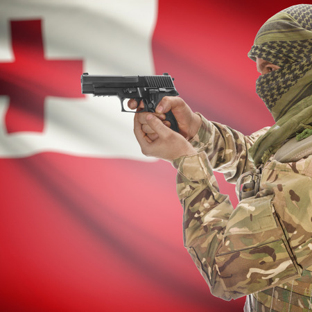 national police agency: Man with gun in hand and national flag on background series - Tonga