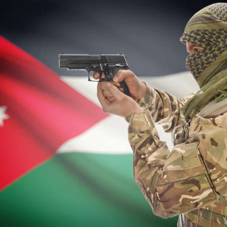 counterterrorism: Man with gun in hand and national flag on background series - Jordan