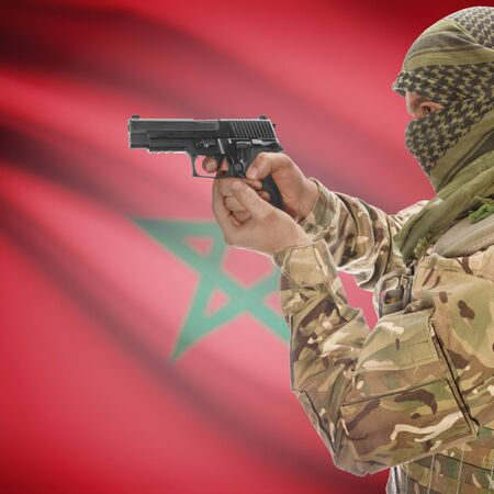 counterterrorism: Man with gun in hand and national flag on background series - Morocco