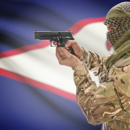 counterterrorism: Man with gun in hand and national flag on background series - American Samoa