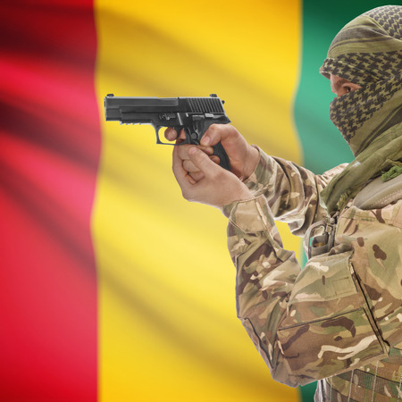 national police agency: Man with gun in hand and national flag on background series - Guinea