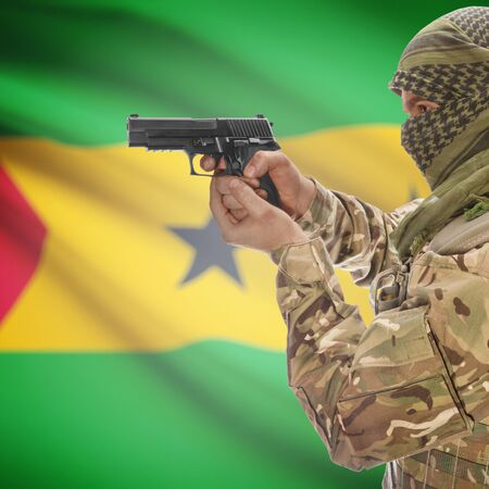 national police agency: Man with gun in hand and national flag on background series - Sao Tome and Principe