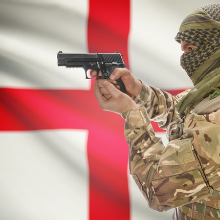 counterterrorism: Man with gun in hand and national flag on background series - England