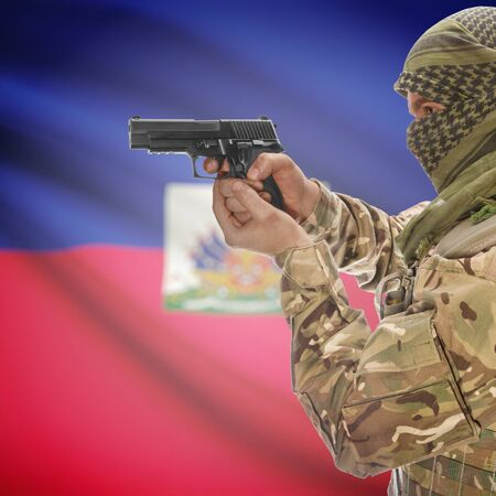 insurgency: Man with gun in hand and national flag on background series - Haiti