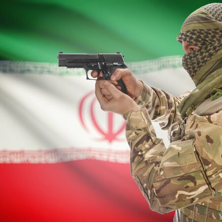 insurgency: Man with gun in hand and national flag on background series - Iran