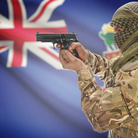 anti terrorist: Man with gun in hand and national flag on background series - Cayman Islands Stock Photo