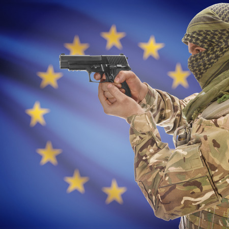 counterterrorism: Man with gun in hand and national flag on background series - European Union - EU Stock Photo