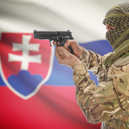 counterterrorism: Man with gun in hand and national flag on background series - Slovakia