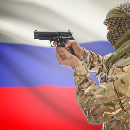 insurgency: Man with gun in hand and national flag on background series - Russia