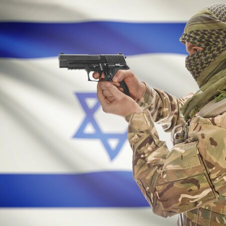 national police agency: Man with gun in hand and national flag on background series - Israel