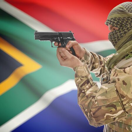 counterterrorism: Man with gun in hand and national flag on background series - South Africa
