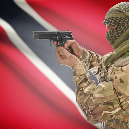 counterterrorism: Man with gun in hand and national flag on background series - Trinidad and Tobago Stock Photo