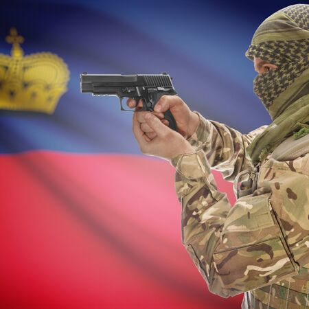 national police agency: Man with gun in hand and national flag on background series - Liechtenstein