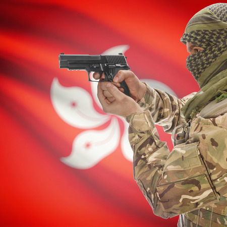 national police agency: Man with gun in hand and national flag on background series - Hong Kong Stock Photo