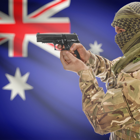 counterterrorism: Man with gun in hand and national flag on background series - Australia