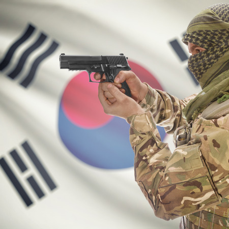 insurgency: Man with gun in hand and national flag on background series - South Korea