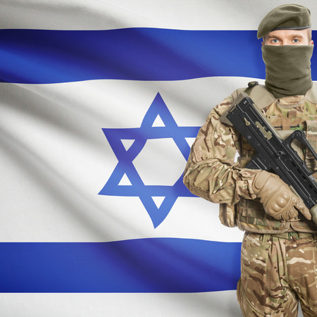 border patrol: Soldier with machine gun and national flag on background series - Israel