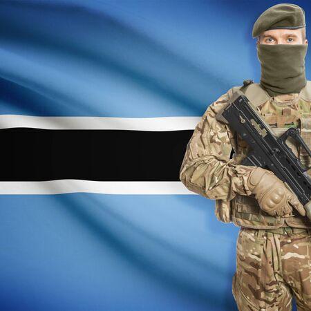 botswanan: Soldier with machine gun and national flag on background series - Botswana Stock Photo