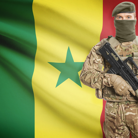 peacemaker: Soldier with machine gun and national flag on background series - Senegal Stock Photo