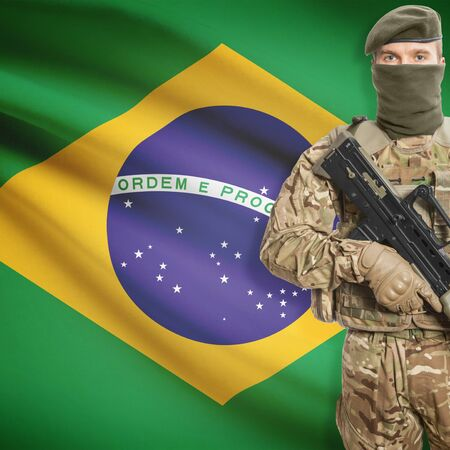 law of brazil: Soldier with machine gun and national flag on background series - Brazil