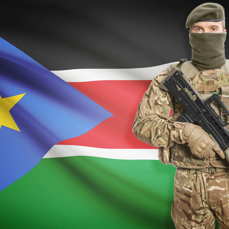 peacemaker: Soldier with machine gun and national flag on background series - South Sudan Stock Photo