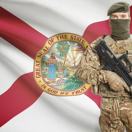 floridian: Soldier with machine gun and USA state flag on background series - Florida