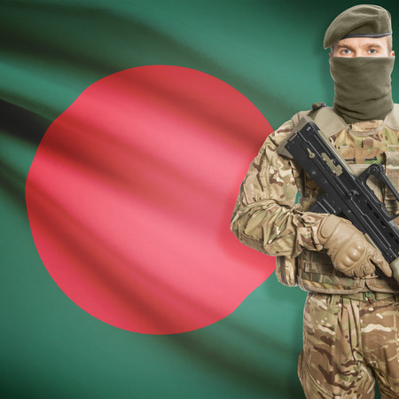 border patrol: Soldier with machine gun and national flag on background series - Bangladesh
