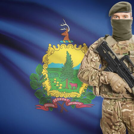 peacemaker: Soldier with machine gun and USA state flag on background series - Vermont Stock Photo