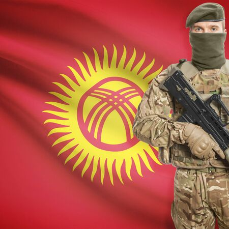 border patrol: Soldier with machine gun and national flag on background series - Kyrgyzstan Stock Photo