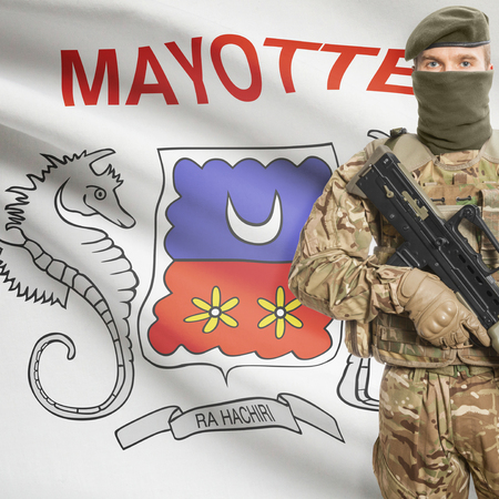 mayotte: Soldier with machine gun and national flag on background series - Mayotte