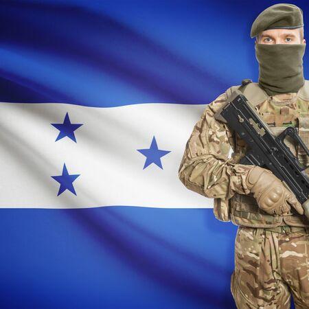 border patrol: Soldier with machine gun and national flag on background series - Honduras