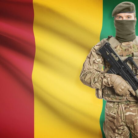 border patrol: Soldier with machine gun and national flag on background series - Guinea