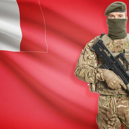 border patrol: Soldier with machine gun and national flag on background series - Wallis and Futuna