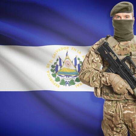 border patrol: Soldier with machine gun and national flag on background series - El Salvador