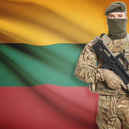 lithuanian: Soldier with machine gun and national flag on background series - Lithuania Stock Photo