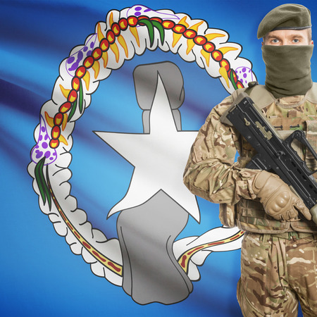 mariana: Soldier with machine gun and national flag on background series - Northern Mariana Islands