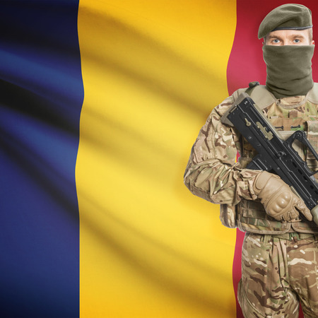 chadian: Soldier with machine gun and national flag on background series - Chad