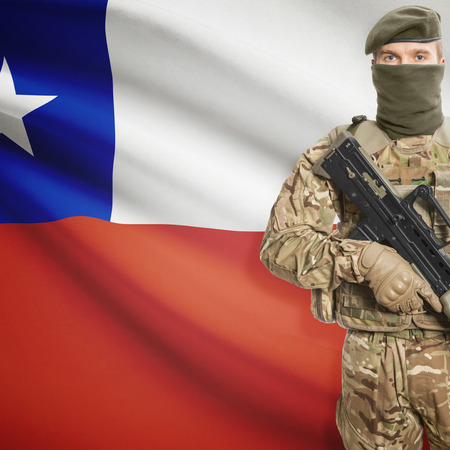 chile: Soldier with machine gun and national flag on background series - Chile