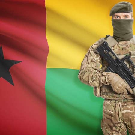 border patrol: Soldier with machine gun and national flag on background series - Guinea-Bissau
