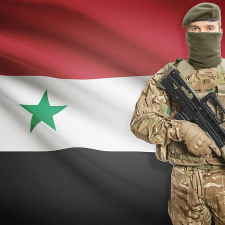 syria peace: Soldier with machine gun and national flag on background series - Syria Stock Photo